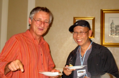 """Definitely time for dessert, and do not disturb!"" they seem to be saying. Jean-Christophe Glaszmann (left) and Hei Leung (right), who played ace roles on a multi-partner GCP project on bananas."