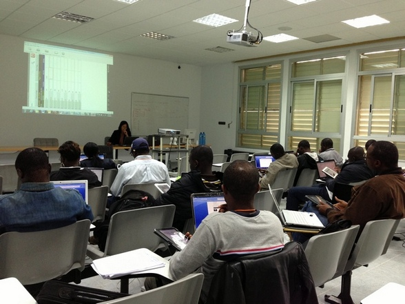 An IB-MYC training course in session in April 2013 for the West and Central Africa group. Clarissa Pimentel, IBP's Data Manager/Training Specialist, at the front, traching trainees tricks on using Fieldlab in the tablet for data collection.