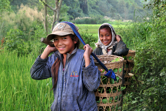 Girls help in the fields in Luang Prabang, Laos.